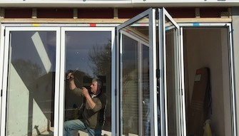 Supply and installation of external bi fold doors. - Epsom and Ewell, KT18